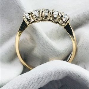 Jewelry - 14K Gold Band With Five mounted Diamonds. Size 8.